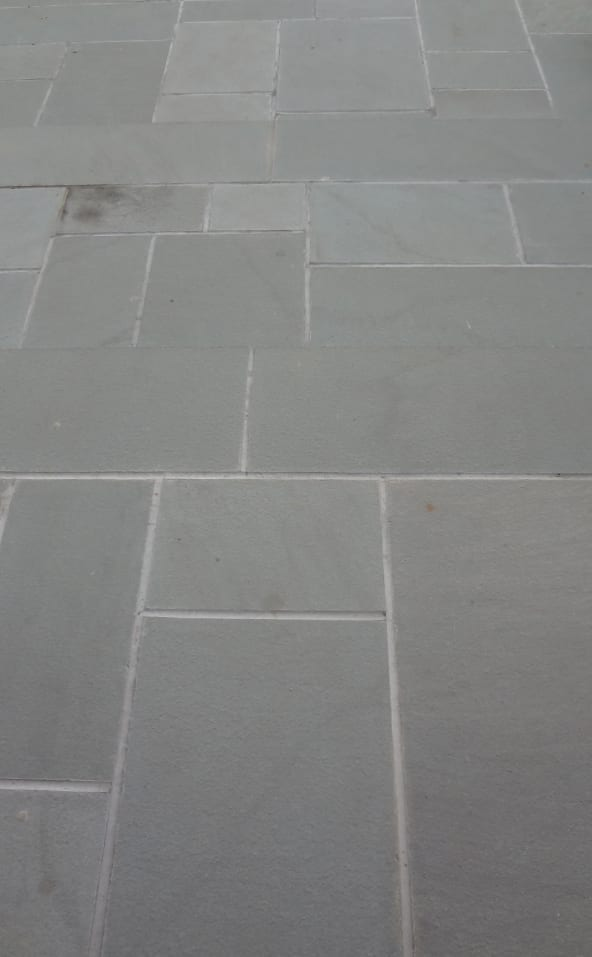 Walkway of blue blue bluestone, sawn thermal (smooth) finish.