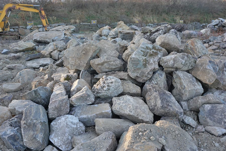 Part of our Indian Hill® boulder wall stone inventory at Wicki Stone.