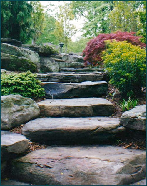 PA Colonial Stone Steps instantly provide an aged, classic look to any landscape