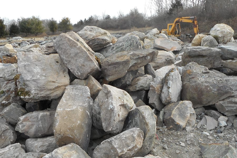 Our on-site boulder piles can be a source for placement rocks. You pick your favorite boulders.