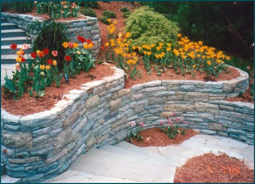 Mixed Karney® and snapped bluestone wall stone expertly installed