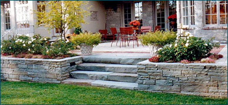 Snapped bluestone wall and snapped bluestone steps make a neat and elegant wall stone/step combination.