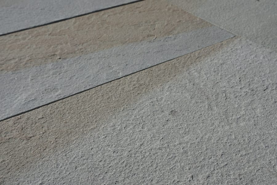 Close-up picture of a sawn thermal bluestone finish