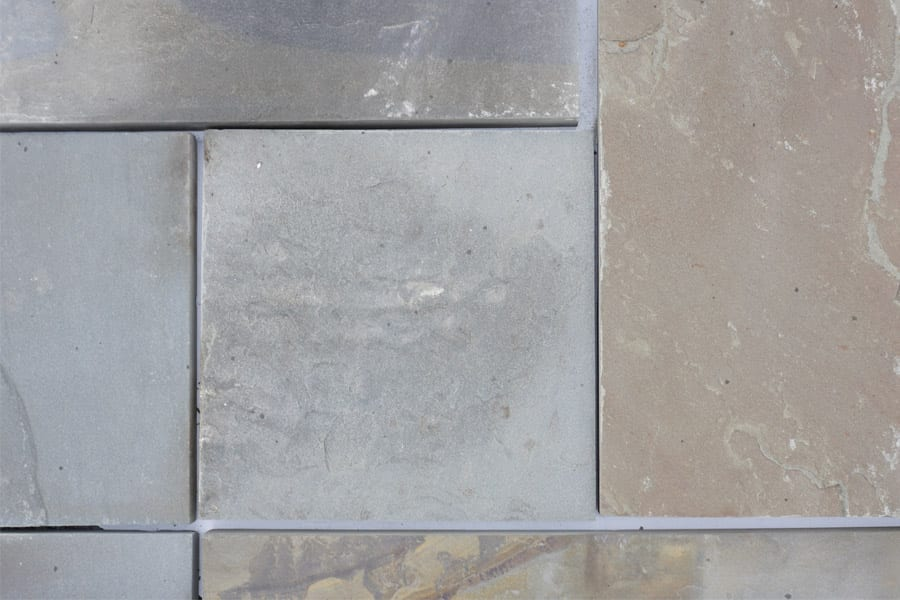 A picture of full range color natural cleft finish, pattern bluestone that shows the earth tone colors and more
